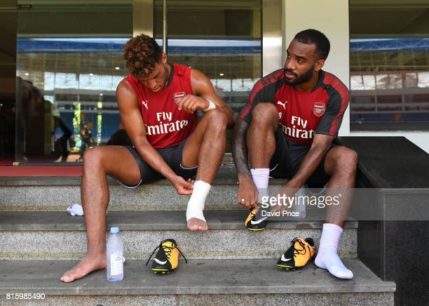 Alex OxladeChamberlain and Alexandre Lacazette of Arsenal during an Arsenal Training Session at Yuanshen Sports Centre Stadium on July 17 2017 in...