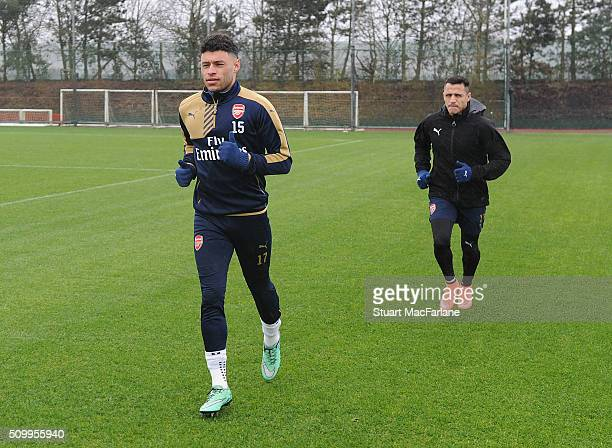 abd12fe4612e63 Alex OxladeChamberlain and Alexis Sanchez of Arsenal during a training  session at London Colney on February