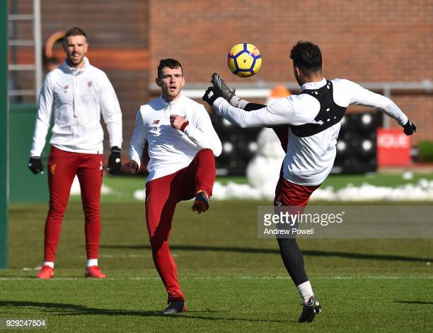 Alex OxladeChamberlain and Andrew Robertson of Liverpool during a training session at Melwood Training Ground on March 8 2018 in Liverpool England