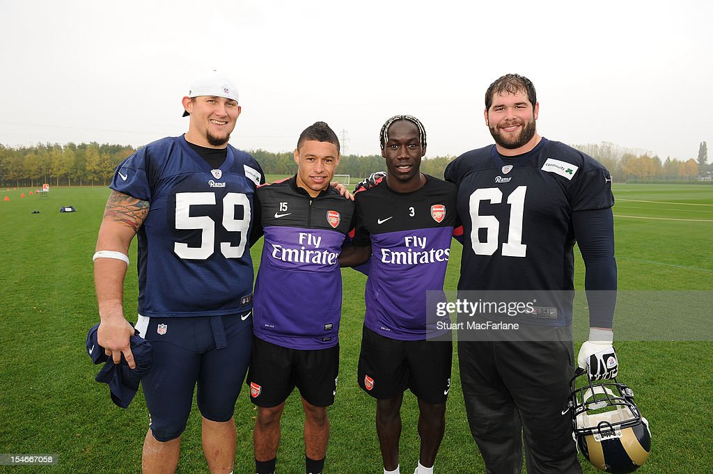 Alex Oxlade-Chamberlain and Bacary Sagna of Arsenal with (L) Rob Turner and (R) Tim Barnes of the St Louis Rams at London Colney on October 24, 2012 in St Albans, England.
