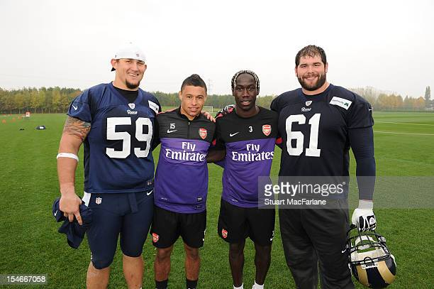 Alex OxladeChamberlain and Bacary Sagna of Arsenal with Rob Turner and Tim Barnes of the St Louis Rams at London Colney on October 24 2012 in St...