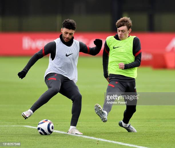 Alex Oxlade-Chamberlain and Conor Bradley of Liverpool during a training session at AXA Training Centre on May 04, 2021 in Kirkby, England.