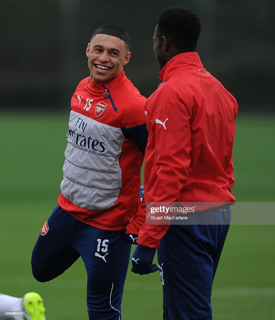 Alex Oxlade-Chamberlain and Danny Welbeck of Arsenal during a training session at London Colney on December 5, 2014 in St Albans, England.
