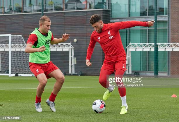 Alex OxladeChamberlain and Herbie Kane of Liverpool during a training session at Melwood Training Ground on October 15 2019 in Liverpool England