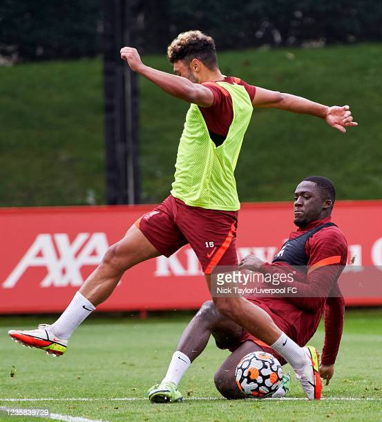 Alex Oxlade-Chamberlain and Ibrahima Konate of Liverpool during a training session at AXA Training Centre on October 12, 2021 in Kirkby, England.