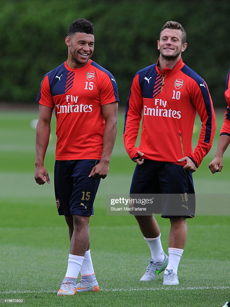 Alex Oxlade-Chamberlain and Jack Wilshere of Arsenal during a training session at London Colney on July 8, 2015 in St Albans, England.
