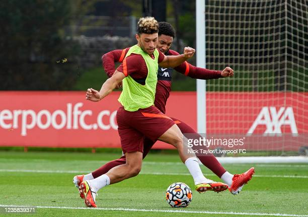 Alex Oxlade-Chamberlain and Joe Gomez of Liverpool during a training session at AXA Training Centre on October 12, 2021 in Kirkby, England.