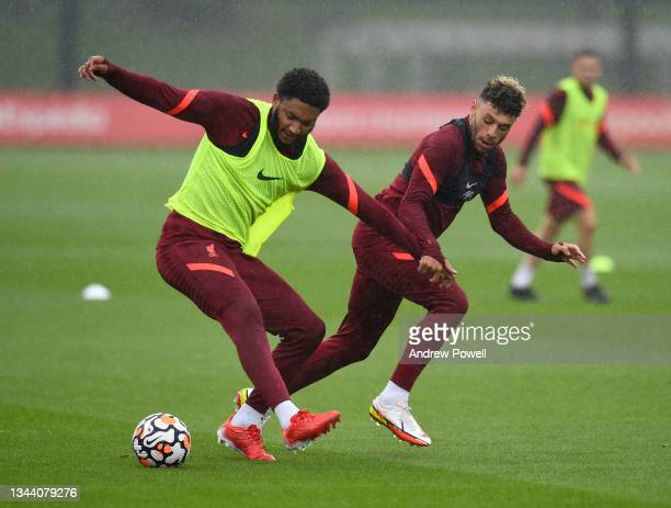 Alex Oxlade-Chamberlain and Joe Gomez of Liverpool during a training session at AXA Training Centre on September 30, 2021 in Kirkby, England.