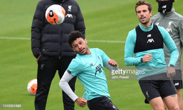 Alex OxladeChamberlain and Jordan Henderson captain of Liverpool during a training session at Melwood Training Ground on June 03 2020 in Liverpool...