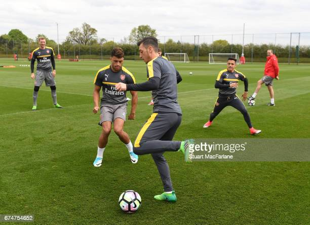 Alex OxladeChamberlain and Mesut Ozil of Arsenal during a training session at London Colney on April 29 2017 in St Albans England