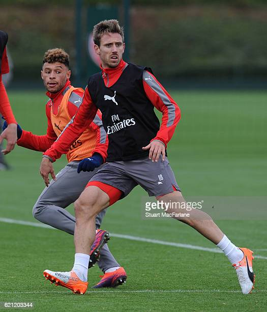Alex OxladeChamberlain and Nacho Monreal of Arsenal during a training session at London Colney on November 5 2016 in St Albans England