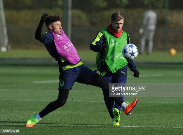 Alex Oxlade-Chamberlain and Nacho Monreal of Arsenal during a training session at London Colney on February 13, 2017 in St Albans, England.