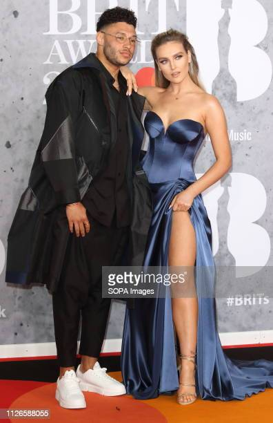 Alex OxladeChamberlain and Perrie Edwards are seen on the red carpet during The BRIT Awards 2019 at The O2 Peninsula Square in London