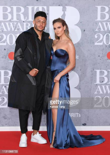 Alex OxladeChamberlain and Perrie Edwards attend The BRIT Awards 2019 held at The O2 Arena on February 20 2019 in London England