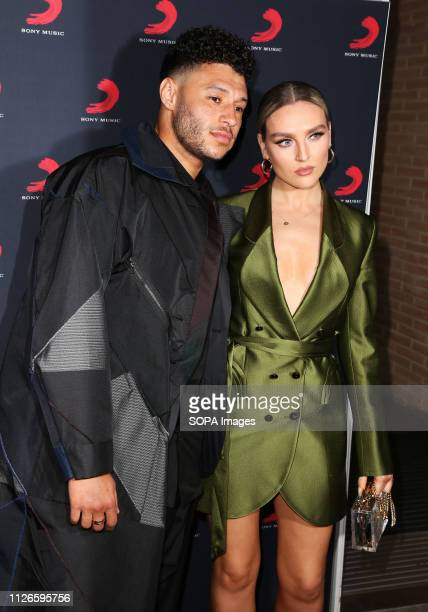 Alex OxladeChamberlain and Perrie Edwards seen at the Sony Music After Party for The Brit Awards 2019 at The Shard in London