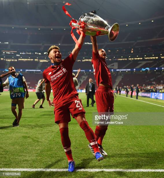 Alex Oxlade-Chamberlain and Rhian Brewster of Liverpool celebrate with the trophy during the UEFA Champions League Final between Tottenham Hotspur...
