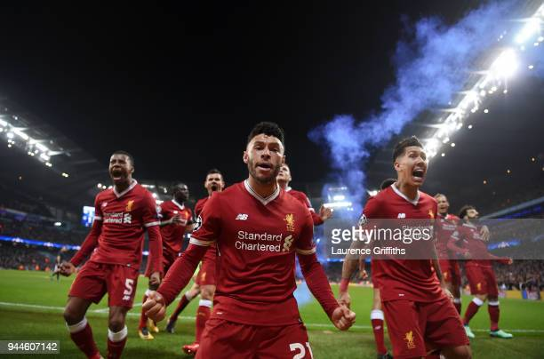 Alex OxladeChamberlain and Roberto Firmino of Liverpool celebrate their sides first goal scored by Mohamed Salah during the Quarter Final Second Leg...