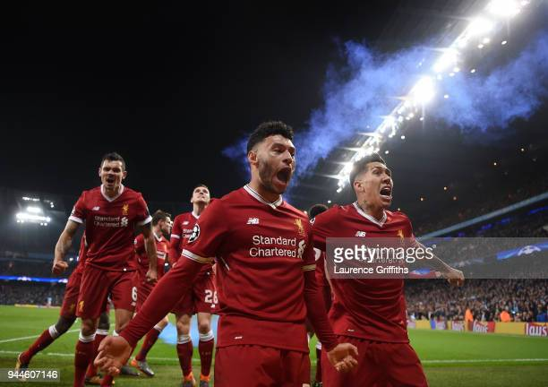 Alex Oxlade-Chamberlain and Roberto Firmino of Liverpool celebrate their sides first goal scored by Mohamed Salah during the Quarter Final Second Leg...