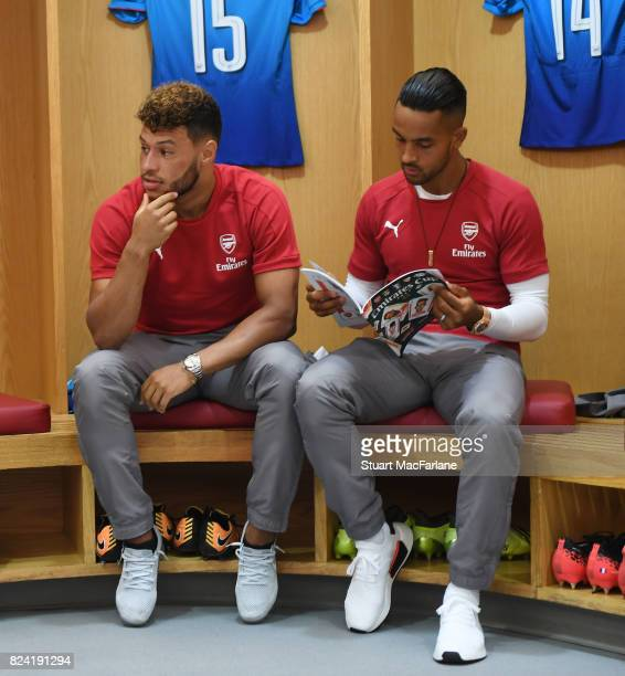 Alex OxladeChamberlain and Theo Walcott in the Arsenal changing room before the Emirates Cup match between Arsenal and SL Benfica at Emirates Stadium...
