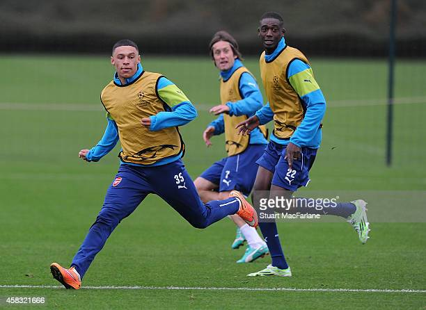 Alex OxladeChamberlain and Yaya Sanogo of Arsenal during a training session at London Colney on November 3 2014 in St Albans England Photo by Stuart...