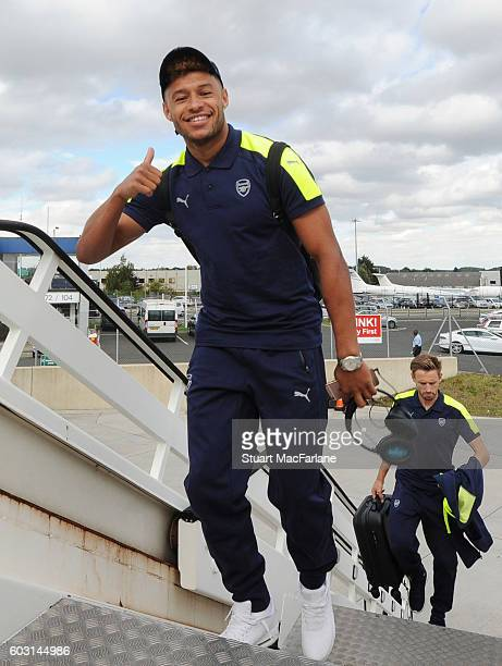 Alex OxladeChamberlain boards the Arsenal plane to Paris at Luton Airport on September 12 2016 in Luton England
