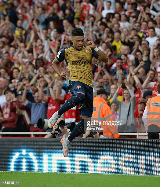 Alex OXladeChamberlain celebrates scoring a goal for Arsenal during the match between Arsenal and Olympic Lyon at Emirates Stadium on July 25 2015 in...