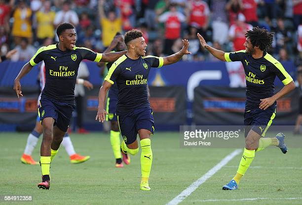 Alex OxladeChamberlain celebrates scoring Arsenal's 2nd goal with Alex Iwobi and Mohamed Elneny during the match between Arsenal and CD Guadalajara...