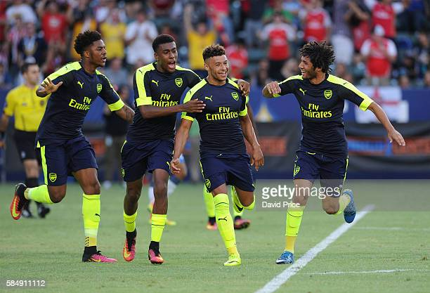 Alex OxladeChamberlain celebrates scoring Arsenal's 2nd goal with Chuba Akpom Alex Iwobi and Mohamed Elneny during the match between Arsenal and CD...
