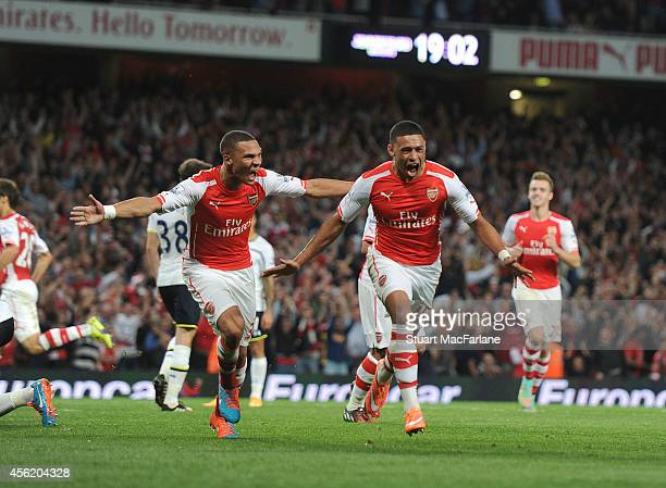 Alex OxladeChamberlain celebrates scoring for Arsenal with Kieran Gibbs during the Barclays Premier League match between Arsenal and Tottenham at...