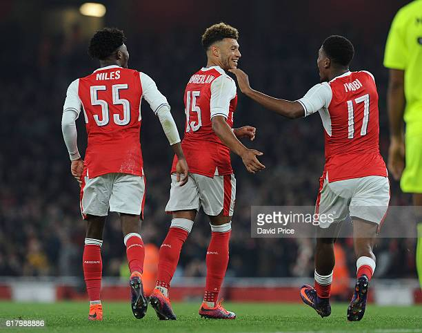 Alex OxladeChamberlain celebrates scoring his and Arsenal's 2nd goal with Ainsley MaitlandNiles and Alex Iwobi during the match between Arsenal and...