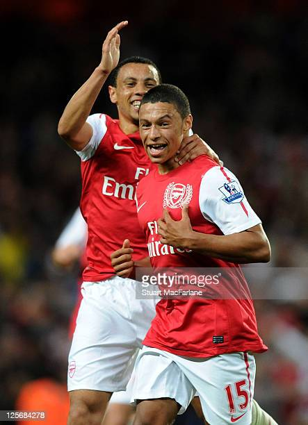 Alex OxladeChamberlain celebrates scoring the 1st Arsenal goal with Francis Coquelin during the Carling Cup Third Round match between Arsenal and...