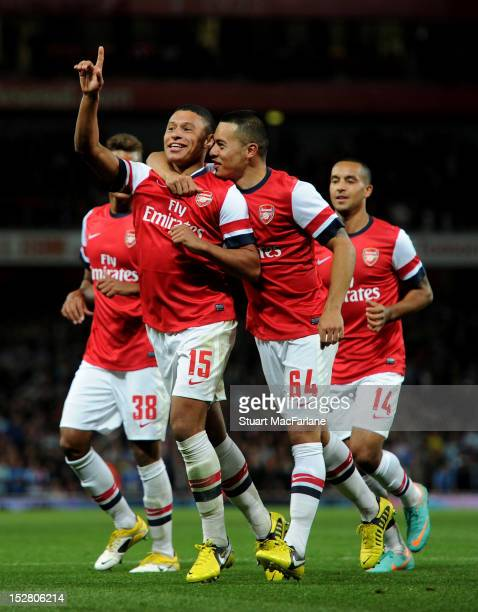 Alex OxladeChamberlain celebrates scoring the 2nd Arsenal with Nico Yennaris during the Capital One Cup match between Arsenal and Coventry City at...