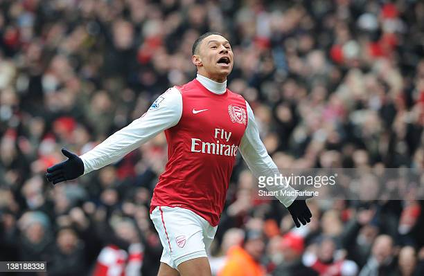 Alex OxladeChamberlain celebrates scoring the 3rd Arsenal goal during the Barclays Premier League match between Arsenal and Blackburn Rovers at...
