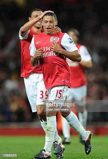 Alex OxladeChamberlain celebrates scoring the second Arsenal goal with Franci Coquelin during the Carling Cup Third Round match between Arsenal and...
