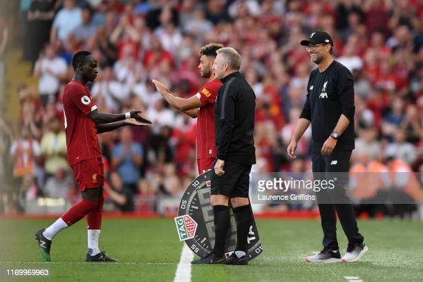 Alex OxladeChamberlain comes on as a substitute for Sadio Mane of Liverpool during the Premier League match between Liverpool FC and Arsenal FC at...