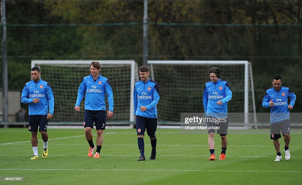 ST. ALBANS, ENGLAND - (L-R) Alex Oxlade-Chamberlain, Kim Kallstrom, Aaron Ramsey, Tomas Rosicky and Santi Cazorla of Arsenal during a training session at London Colney on April 11, 2014 in St Albans, England.