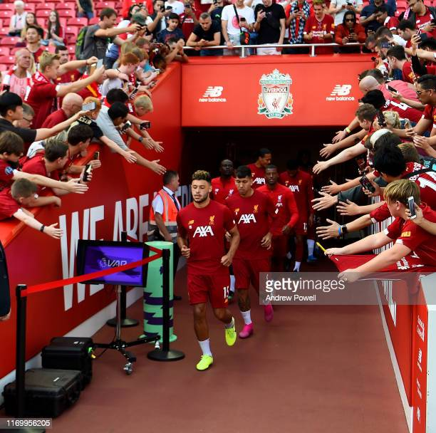 Alex OxladeChamberlain Leads Liverpool out beforte the Premier League match between Liverpool FC and Arsenal FC at Anfield on August 24 2019 in...