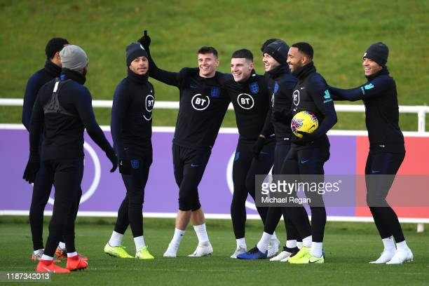 Alex Oxlade-Chamberlain Mason Mount, Declan Rice, Tyrone Mings James Maddison, Callum Wilson, Jadon Sancho and team mates share a joke as they attend...