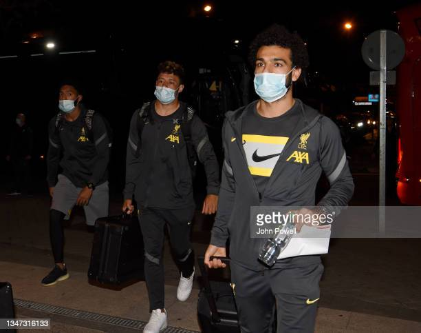 Alex Oxlade-Chamberlain, Mohamed Salah and Joe Gomez of Liverpool arriving before the UEFA Champions League group B match between Atletico Madrid and...