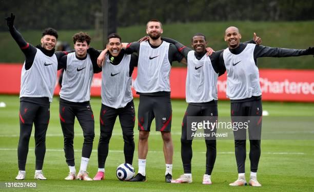 Alex Oxlade-Chamberlain, Neco Williams, Roberto Firmino, Nathaniel Phillips, Georginio Wijnaldum and Fabinho of Liverpool pose for a photograph...