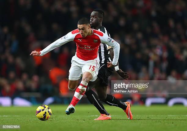 Alex OxladeChamberlain of Arsenal and Cheik Ismael Tiote of Newcastle United