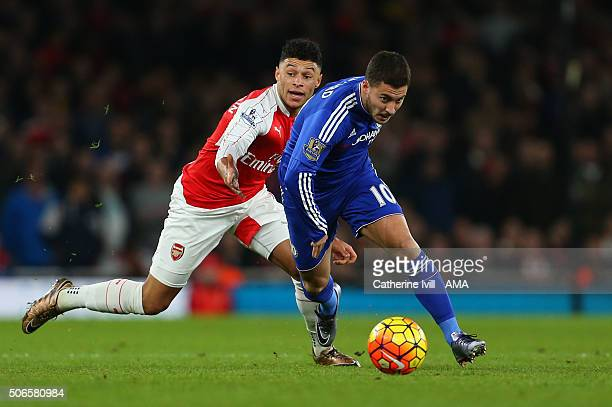 Alex OxladeChamberlain of Arsenal and Eden Hazard of Chelsea during the Barclays Premier League match between Arsenal and Chelsea at the Emirates...
