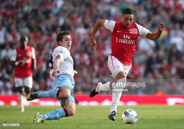 Alex OxladeChamberlain of Arsenal and Gary Gardner of Aston Villa in action during a Barclays Premier League match at the Emirates on March 24 2012...