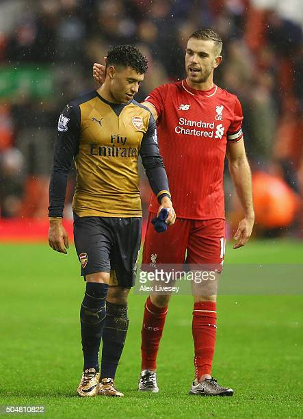 Alex OxladeChamberlain of Arsenal and Jordan Henderson of Liverpool applaud after their 33 draw in the Barclays Premier League match between...