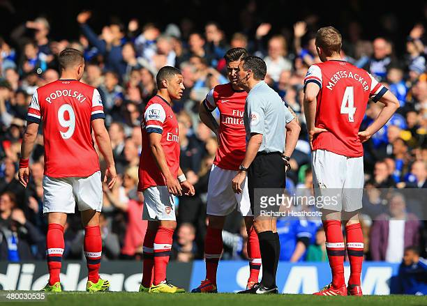 Alex OxladeChamberlain of Arsenal appeals to Referee Andre Marriner after he gave Kieran Gibbs of Arsenal a red card during the Barclays Premier...