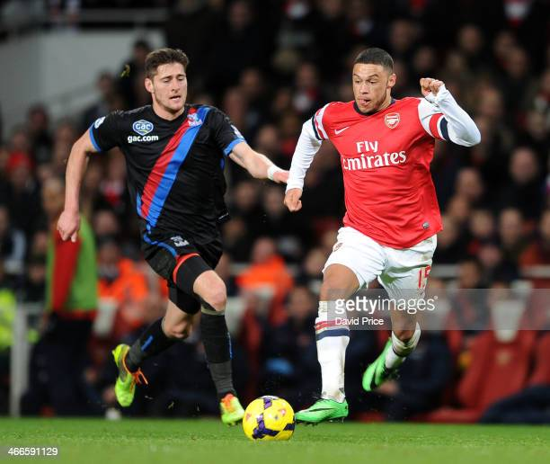 Alex OxladeChamberlain of Arsenal bursts past Joel Ward of Palace the match between Arsenal and Crystal Palace in the Barclays Premier League at...