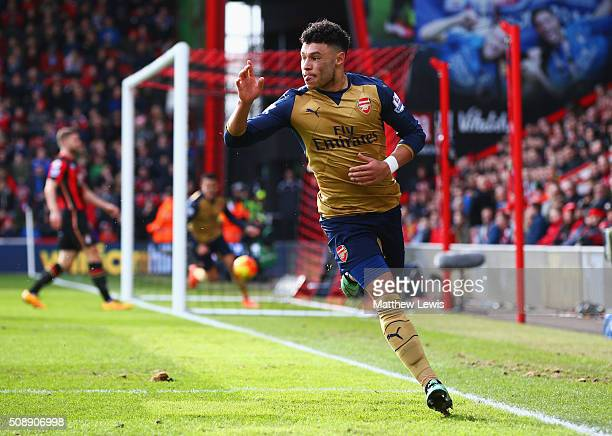 Alex OxladeChamberlain of Arsenal celebrates as he scores their second goal during the Barclays Premier League match between AFC Bournemouth and...