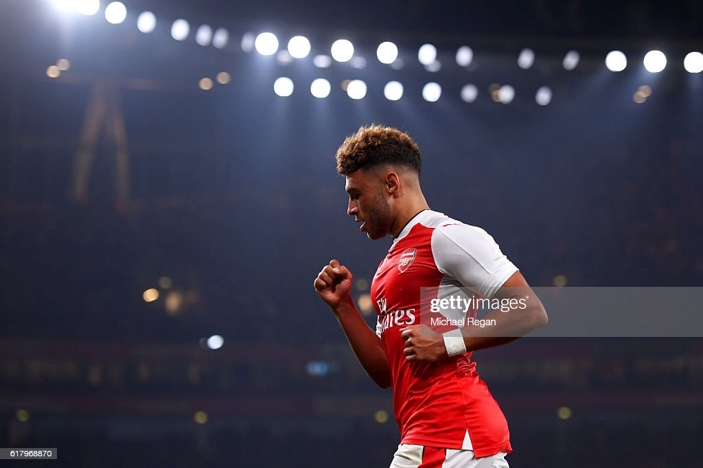 Alex Oxlade-Chamberlain of Arsenal celebrates scoring his sides first goal during the EFL Cup fourth round match between Arsenal and Reading at Emirates Stadium on October 25, 2016 in London, England.