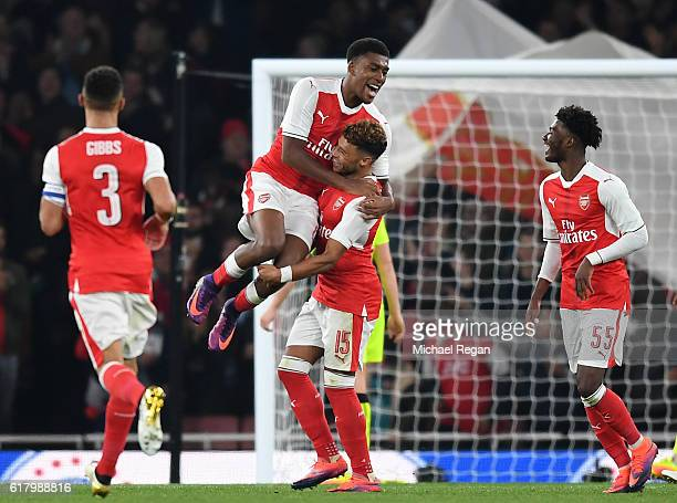 Alex OxladeChamberlain of Arsenal celebrates scoring his sides first goal with Alex Iwobi of Arsenal during the EFL Cup fourth round match between...