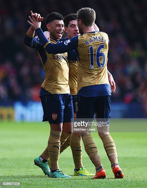Alex OxladeChamberlain of Arsenal celebrates with Hector Bellerin and Aaron Ramsey as he scores their second goal during the Barclays Premier League...